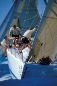 Crew preparing to hoist spinnaker approaching windward mark SORC