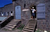 Man standing in doorway of Poice station, Nevis, Caribbean
