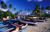 Small fishing boats on sandy beach - Nevis, Caribbean