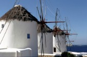 Three white windmills, found on the Greek island of Mykonos