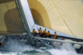 Crew on windward rail of classic yacht Valsheda in rough seas