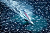 Aerial view of windsurfer speeding through the water