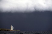 Yacht sailing under stormy sky