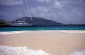 Swan 55 at anchorage by a sandy spit in the Caribbean