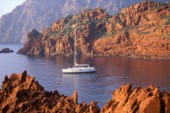 40ft cruising yacht at anchor in a secluded bay in Corsica in the Mediterranean