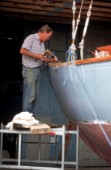 A Boat Builder carefully restores a classic sailing yacht
