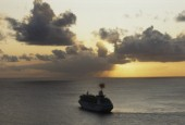 Aerial View of cruise ship under way at sunset
