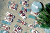Aerial view of sunbathers by a hotel pool