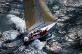 Aerial view of racing yacht Oracle in rough seas during the 1991 Admirals Cup