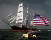 The Star of India out for a rare sail off San Diego is greeted by canoe clubs and Da Woody wagon with a large Stars and Stripes to show his support to the Star and troops