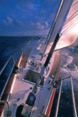 Looking astern from the bow of a large cruising yacht with cutter rig