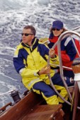 Couple on board sailing yacht