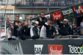 Crew members onboard Team New Zealands NZL-82 wave at fans before race four of the Americas Cup in Auckland, New Zealand. Feb, 25. 2002. Alinghi Swiss Challenge lead Team New Zealand 3-0 in the best of nine races.