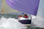 Purple J80 sportsboat Just Savage planing and surfing downwind at 20 knots under asymmetric spinnaker, roller furled jib and 3DL main.