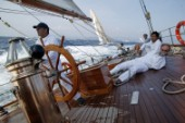 Helmsman and crew on aft deck of classic yacht Eleanora during the Voiles de St Tropez 2004