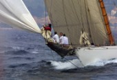 Crew on bowsprit of classic yacht