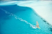 Aerial view of windsurfer speeding over calm, clear sea