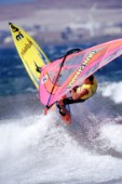 Windsurfer jumping off wave
