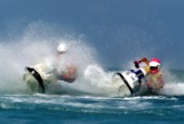 Two Jet Ski riders turning sharply during race