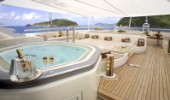 Champagne and jacuzzi on aft deck of superyacht