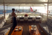 Woman in evening dress on aft deck of superyacht