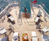 Sun loungers and chairs on aft deck of superyacht