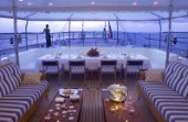 Table laid for dinner on the aft deck of superyacht