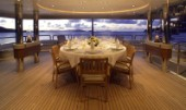 Table laid for dinner on aft deck of superyacht