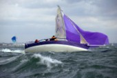 Purple J80 Just Savage in severe broach during a fast downwind run in Cowes Week 2004