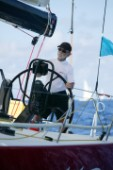 Antigua Sailing Week 2005. TITAN 12, Owner Tom Hill at the helm