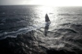 Vendee Globe Open 60 yacht Hugo Boss skippered by Alex Thomson sailing in rough water and strong breeze