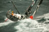 Vendee Globe Open 60 yacht Hugo Boss skippered by Alex Thomson powering through rough seas in strong winds
