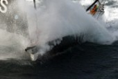 Vendee Globe Open 60 yacht Hugo Boss skippered by Alex Thomson crashing through rough seas in strong winds
