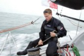 Skipper of the Open 60 Ocean yacht Alex Thomson tailing a winch
