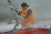 Skipper of the Open 60 Ocean yacht Alex Thomson gets  soaked in rough seas