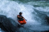 Canoeist paddling down rapids on the Zambezi River, Zambia