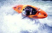 Canoeist makes sharp turn over rapids on the Zambezi River, Zambia