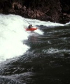 Canoeist paddling through big rapids on the Zambezi River, Zambia