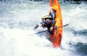 Canoeist negotiates rapids on the Zambezi River, Zambia