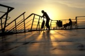 Silhouetted figures on deck of ferry, Patras, Greece
