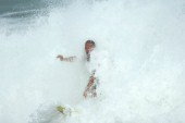 Surfer nearly wipes out in big surf at the Rip Curl Championship 2005