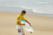 Competitor waxing his board at the Rip Curl Championship 2005
