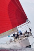 Flying Dragon under red spinnaker at Antigua Sailing Week