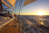 Sailing a cruising yacht in the sunset