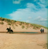 Pony trekking along beach near Aberdeen, Scotland