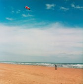 Man kite boarding on flat sandy beach near Aberdeen, Scotland