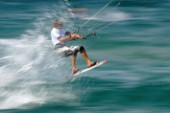 Kitesurfer gets air of a wave in strong winds