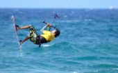 Kitesurfer in mid air in strong breeze