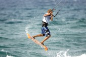 Kitesurfer gets air in strong winds