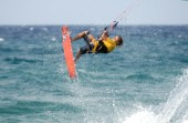 Kitesurfer get big air in strong winds